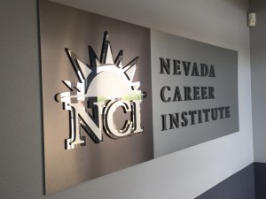 NCI-acrylic lobby logo panel with mixed metal laminate