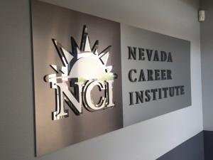 NCI-acrylic lobby logo panel with mixed metal laminate