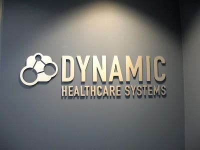 Dynamic-Healthcare-Systems-Satin-Aluminum-Laminate-over-Dark-Blue-Acrylic