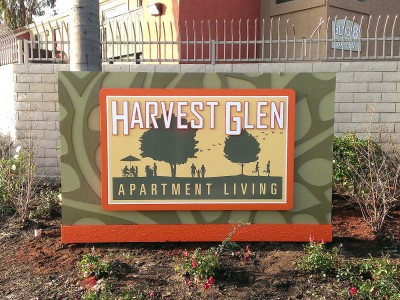 Immersive-Identity-Harvest-Glenn-rigid-sign-face-on-cabinet