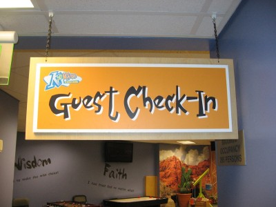 Kid-Ventures-Check-In-hanging-sign