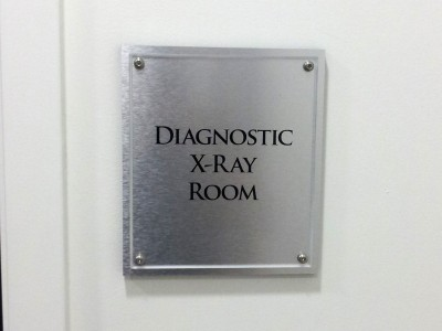 Medical-Specialties-brushed-aluminum-base-with-acrylic-face-room-sign