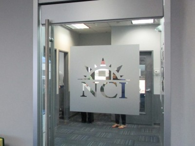NCI-etched-vinyl-logo-on-glass