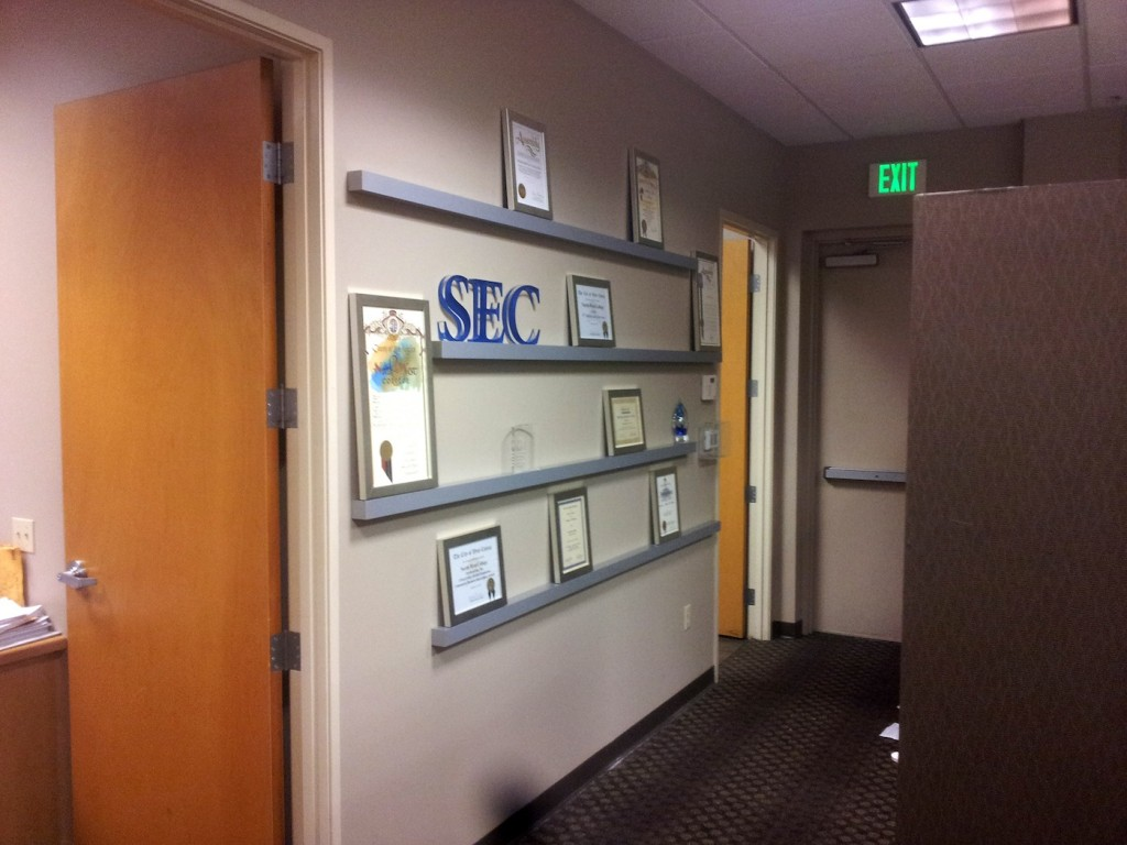 NWC-custom-framed-awards-with-SEC-acrylic-back-painted-logo-letters