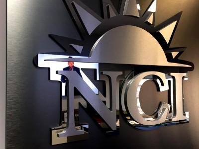 Nevada-Career-Institute-Mixed-Metal-Laminate-Logo-Panel-close-up