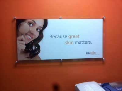 OC-Skin-Institute-Clear-Acrylic-display-with-digital-graphics-and-standoffs