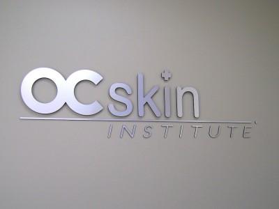 OC-skin-institute-metal-laminate-on-acrylic