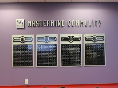 Online-Trading-Academy-Mastermind-Community-Layered-wall-display-with-acrylic-and-metal-laminate