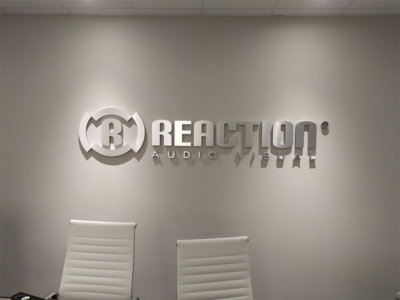 Reaction Metal laminate lobby sign